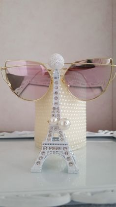 Pink shades and pearl ring from Ebay, both for less than $5, pearl studded candle from I don't know where, Eiffel tower from Kurdistan, Iraq, and picture frame turned tray from a yard sale.  My original photo.♡