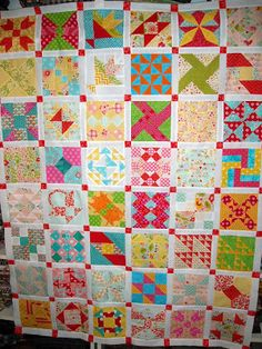 farmer's wife quilt. I like the white sashing and red connecting blocks.