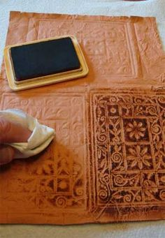 Scrapbooking.com -- Article - Tooled Paper Leather Tutorial by Michael Strong on how to create faux leather. Seems easy enough