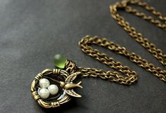 A 25mm bronze bird nest charm, with three little pearl eggs inside and a little bronze robin perched on the edge, has been combined with a delicate glass teardrop wrapped by hand in bronze wire, and a genuine fresh water pearl charm, in this handmade charm necklace.    Necklace comes with a matching bronze chain.  If you would like a length of chain longer than 24 inches, please contact me for pricing.    There are also matching earrings! http://etsy.me/1usSH4S      See more Teardrop Jewelry…