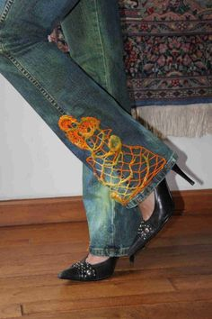 crochet embellished jeans 400x600 10 Ideas for Upcycling Denim with Crochet