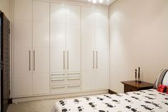 TRADITIONAL HOUSE BY JOOS   Understated built-in cupboards with white satin Supawood doors. http://joos.co.za/traditional-house/
