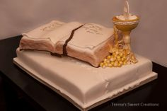 This is a first communion cake, but the design is nice. Could make the base look like a wood table or desk, with a red runner underneath, and put just a standing cross or some other decoration that makes sense rather than the chalice  for the communion.