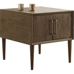 With its tapered peg legs and low, linear profile, this end table with cabinet storage space is a mastery in mid-century minimalism. The look may be high-end gallery design, but the price is beautifully down to earth.