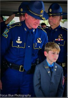 At his father's funeral. Louisiana State Trooper, Steven Vincent