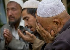 Uighur mollahs praying in Imam Asil tomb in the Taklamakan Desert  Xinjiang, China  http://itunes.com/apps/lafforgueHD