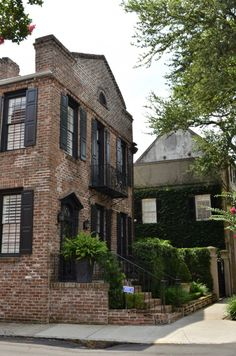 Charleston walking tour includes lots of gorgeous homes. This brick and black shutter home is gorgeous.