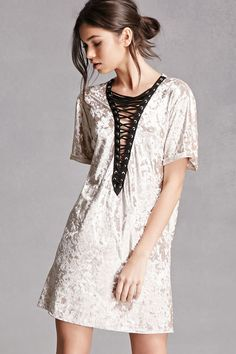 A crushed velvet dress in a boxy silhouette, featuring a plunging lace-up front with grommets, and cuffed short sleeves. This is an independent brand and not a Forever 21 branded item.