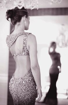 I've always loved open-backed gowns. The lower back is one of the spots I find most sexy!