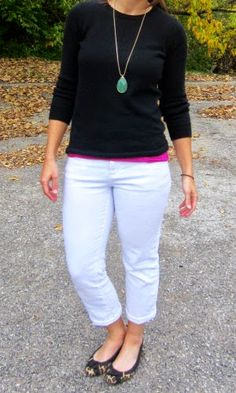 black sweater + green pendant necklace + white jeans