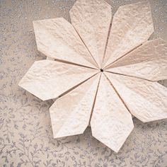 Turn the paper into flowers. Great for decorating gifts!