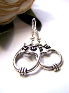 the wee silver owl earrings by barberryandlace on Etsy, $10.00