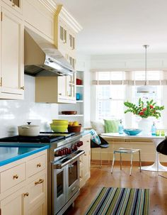 oh hai blue counter tops, fabulous pendant, Lucite chair, tulip table, glass cabs, and sweet bench. can I live here?