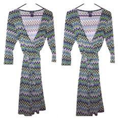 Mini wrap dress Mini wrap dress. Size 14 but can wear as a medium. Soho Apparel ltd Dresses Mini
