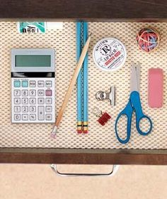 Stop pens and paper clips from rolling to the back of a desk drawer with a nonskid rug pad.