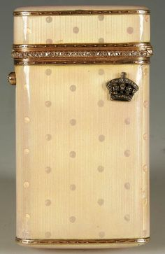 A FABERGE GUILLOCHE ENAMELED GOLD AND DIAMOND SET CIGARETTE CASE, workmaster Michael Perchin, St. Petersburg 1899-1908. The surface enameled in pink over a guilloche ground of reeds and pellets. One side set with a gem-set crown. The lip with diamond border and the thumbpiece set with a diamond.