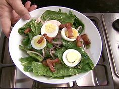 Classic Spinach Salad : Alton Brown tosses a classic spinach salad with warm bacon vinaigrette.