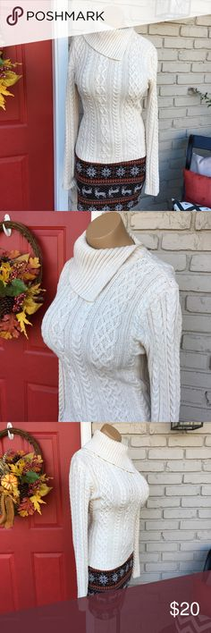 Beautiful cream sweater So pretty! Cream sweater with asymmetrical neck/collar. Great condition! Reindeer skirt also listed for sale on my closet :-) WainScott Sweaters