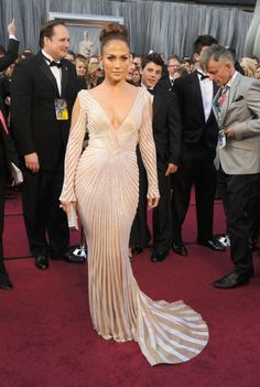 """IRONY!    With Cameron Diaz setting up Edith Head's quote """"Your dresses should be tight enough to show you're a woman.""""  JLo's punch line was: """"but loose enough to show you're a lady.""""    HHHAA"""