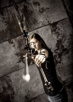 She brought her compound bow for the session- and we knew we had to get this shot! Pic Couture photography studio in Utah! Fun, creative, stylish, dramatic and affordable family photography!  Teen photography.