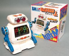 This friction powered Big M Robot Small Type was made in Japan by Yonezawa and is circa 1982. Friction powered, as it travels forward the color wheel in the chest spins. About 5 inches tall and old st