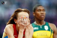 Day 15 - Russia's Mariya Savinova reacts after she won gold ahead of second placed South Africa's Caster Semenya in the women's 800m final at the London 2012 Olympic Games . LUCY NICHOLSON/REUTERS