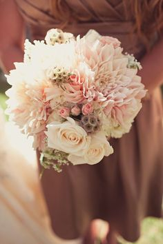 i love the idea of putting heaps of different flowers in.. big, small, different types, different colours :) love this if in the right colours :)