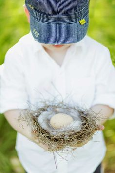 Maternity photo shoot with rustic props. My son holding a bird nest with egg, representing his new brother or sister  Photos by Imagine Images  Prop Styling by Princess Allure Boutique Events