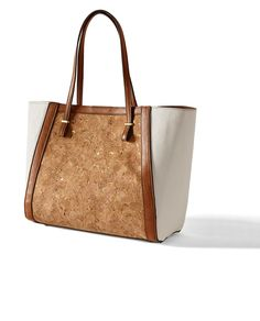 Moms everywhere will love the versatility (and the cork accent) of the Catie Tote.