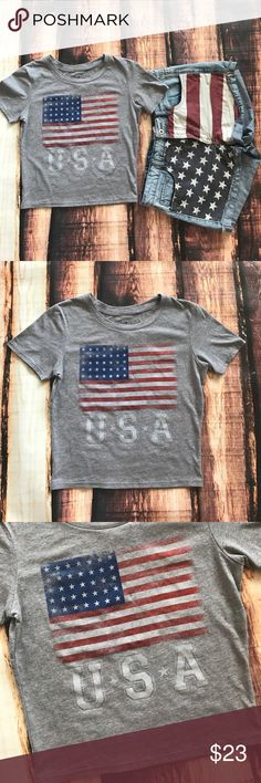 USA American Flag Crop Top Shirt USA!! Show your pride in this sporty little Crop! Perfect with a pair of high waisted shorts! Made of 60% Cotton and 40% Polyester. Size small, will stretch to fit med too! About 19 inches from shoulder seam to bottom hem, about 16.5 inches across bust from armpit to armpit, and about 11 1/2 inches from armpit seam to bottom hem. Boutique Tops Crop Tops