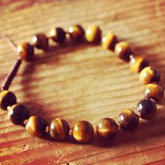 New Tiger's Eye Wrist Mala!  http://theeasiersofterway.com/product/tigers-eye-wrist-mala/  Tiger's Eye promote focus and concentration. His Holiness the Dalai Lama often wears a Tiger's Eye mala himself.  #mala #malabeads #bracelet #tigereye #tigerseye #jewelry #focus #concentration #buddhism
