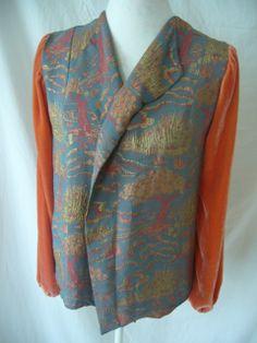 Vintage waistcoat where we added sleeves in velvet