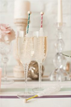 Champagne with rock crystal sticks. Try colored rock crystals to match the party colors.