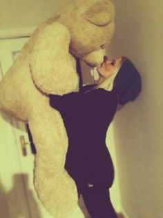((Pretend she has brown hair)) Look me and my teddy bear are dating! *laughs* ~ Cait