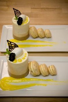 A trio of mousses (Milk Chocolate, Earl Grey & Vanilla Bean) with Earl Grey French Macarons filled with Mango Cream, Mango Curd Sauce, Vanilla Chantilly Cream and garnished with Chocolate Leaf Decoration, Fresh Blackberry & Mint.