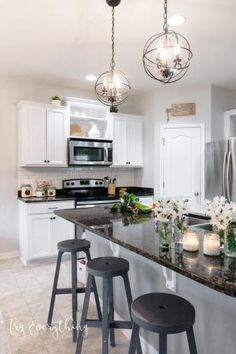 DIY Modern Farmhouse Kitchen Makeover at TryEverythingBlog.com - white cabinets | white subway tile | delorean gray grout | industrial pendant lighting | gray kitchen island | two-toned kitchen | open shelving | white kitchen