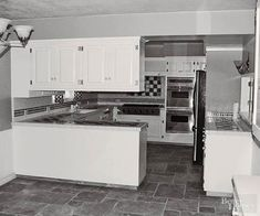 BEFORE: The white U-shape kitchen was functional but boring, and upper cabinets cut off the view between the kitchen and the breakfast area, making the kitchen feel small and dark.