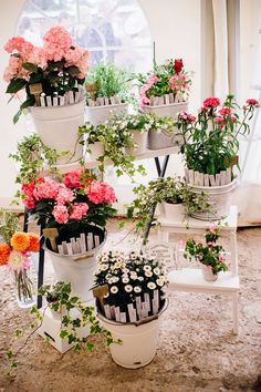 Plant Pot Table Plan   Industrial Florals with Gold Luxe Decor   Mori Lee Wedding Dress   Blue Suede Bridal Shoes   White ASOS Bridesmaid Dresses   Marianne Chua Photography   http://www.rockmywedding.co.uk/helen-craig/