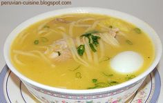 Peruvian chicken soup (stewing chicken, leeks, celery, carrots, ginger, garlic, potatoes, dried egg noodles, hard-boiled eggs, cilantro, scallions, limes, fresh red chile)