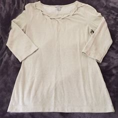 """H&M blouse H&M blouse. Beautiful """"braided"""" neckline. Gold shimmery color. 3/4 sleeve H&M Tops Blouses"""