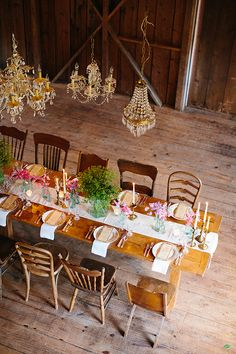 brass taper candles, mismatched chairs, menu, chandeliers, table settings, natural flower bunches. love.