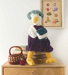 Good old Mother Goose is the imaginary author of many nursery rhymes and songs. She takes great pride in collecting these in her little notebook so she can recount them to all the children. As a fine teacher she deserves a nice red juicy apple for all her efforts.