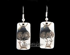 This is an authentic set of Native American sterling silver jewelry earrings. Made by hand, silver Indian jewelry is a traditional handcraft of American Indians of the southwest.Indian jewelry by Nav