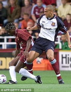 A young Louis Saha proved too much for Rio Ferdinand and the rest of West Ham's defence, above, heading Metz into a 1-0 lead at Upton Park in the 1999 Intertoto Cup final first leg. Frank Lampard missed a penalty as West Ham struggled to show home form dressed strangely in the away kit
