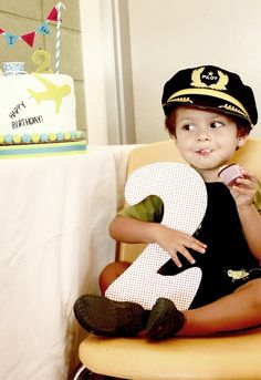 Cute! Take a pic of your child holding a large number of his age next to cake!
