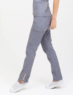 The Moto Pant in Graphite is a contemporary addition to women's medical scrub outfits. ShopJaanuufor scrubs, lab coats and other medical apparel.