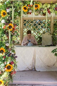 A vibrant Wilde Bunch summer garland for the ceremony pergola at Maunsel House in Somerset. Perfect for outdoor wedding ceremonies. Wedding Ceremonies, Somerset, Summer Wedding, Ladder Decor, Garland, Wedding Flowers, Pergola, Floral Wreath, Vibrant