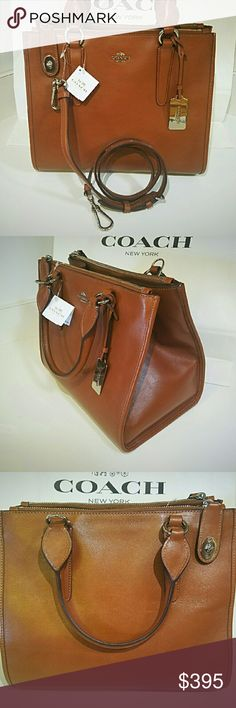 """COACH Silver/Saddle CROSBY Carryall Fashion meets function in the structured Crosby Carryall, a classic silhouette with subtle horse and carriage branding and a diminutive Coach turnlock on the zipper pull. Crafted in hand-worked leather with a rich sheen, it comes finished with bound leather edges, a removable strap and metal feet to protect the leather. This is a definate MUST HAVE  Inside zip and multifunction pockets Detachable shoulder strap Silver hardware 17""""(L) x 8.75""""(H) x 7""""(W)…"""