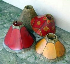 Array of Moroccan lamp shades. Henna painted with the hues of nature.