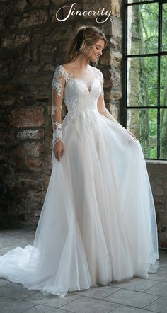 Style 44061: Lace Long Sleeve Illusion A-Line Wedding Dress